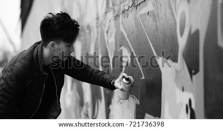 Shutterstock Black White photo of Asian young man outdoors posing at camera
