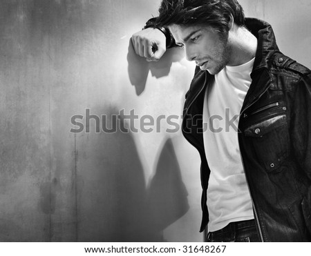 Black white portrait of a melancholic man - stock photo