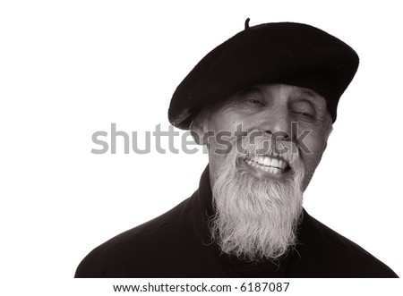 black & white portrait of elderly man with white goatee wearing beret smiling with eyes closed in joyful expression