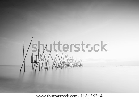 black & white wooden traditional jetty during sunset