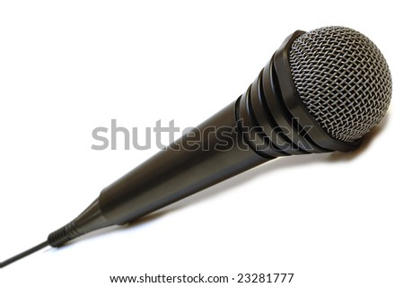 Black wired karaoke microphone with gray metal grill on isolated background.