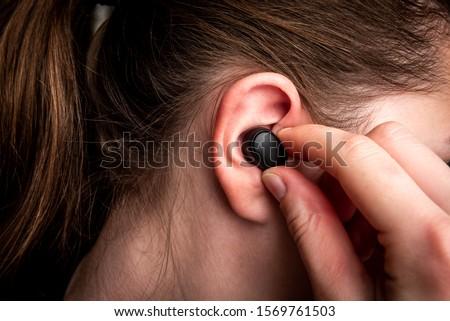 Black wireless headphones in ear. Stock photo ©