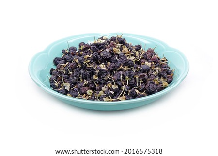 Black wolfberry in ceramic dish isolated on white background. commonly known as black fruit wolfberry, goji nero, siyah goji. Used in traditional Chinese medicine, herbal tea Stok fotoğraf ©