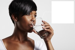 black woman drinking water. note to a water in glass
