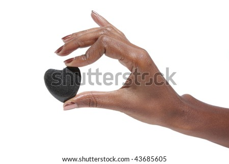 Black Woman holding a heart in her hands