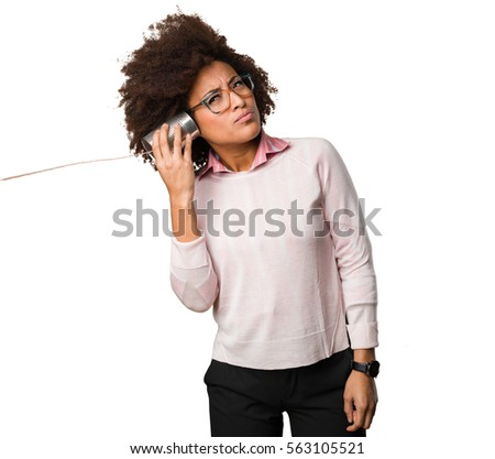 black woman holding a tin can