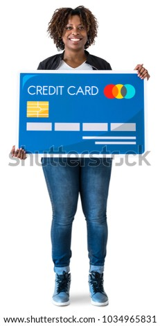 black woman holding credit card ...
