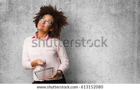 black woman holding shopping...