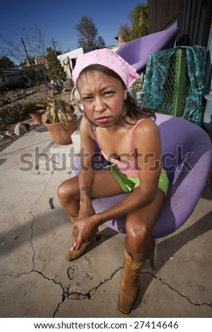 Black woman in front of house with messy yard