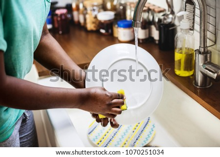 Black woman washing the dish