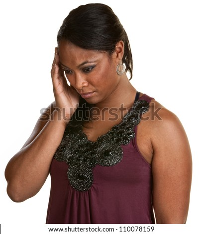 Black woman with hand on head looking down - stock photo