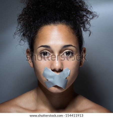 black woman with mouth covered with tape. Concept of forbidden opinion