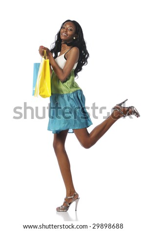 Black woman with shopping bags smiling and isolated on a white background