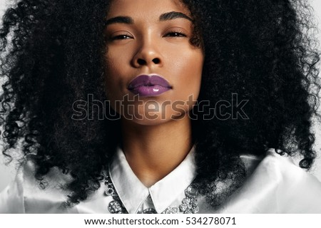 black woman with trendy violet glossy lips #534278071