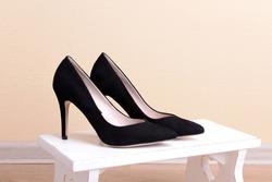 Black women shoes in room