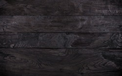 Black wood background, charred planks, painted black stain boards