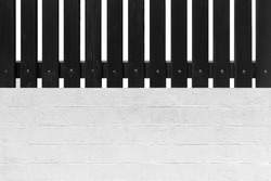 Black wood slat fence and white cement block pattern and background seamless