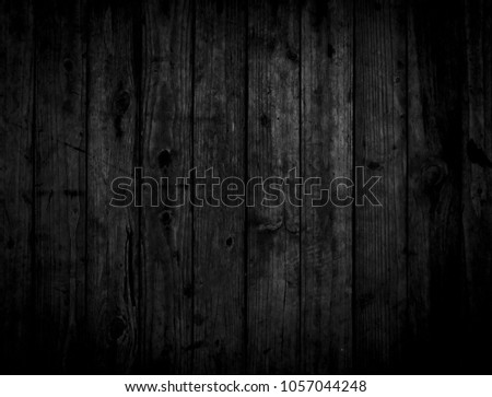 Black wood texture background coming from natural tree. Dark black Wooden panel with beautiful patterns. Space for work #1057044248