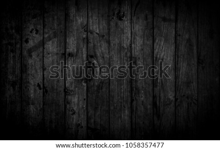 Black wood texture background coming from natural tree. Dark black Wooden panel with beautiful patterns. Space for work #1058357477
