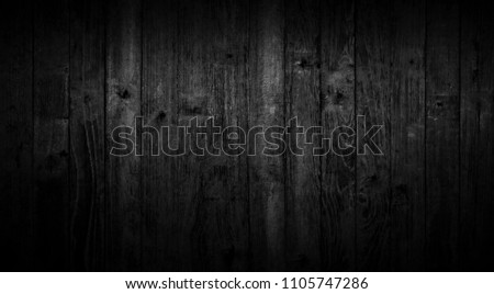 Black wood texture background coming from natural tree. Dark black Wooden panel with beautiful patterns. Space for work #1105747286