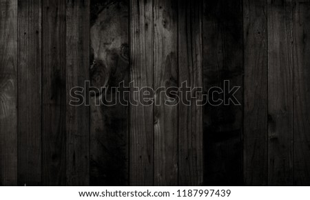 Black wood texture background coming from natural tree. Dark black Wooden panel with beautiful patterns. Space for work #1187997439