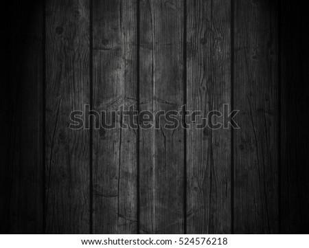 Black wooden background #524576218