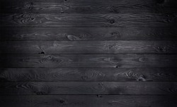 Black wooden background, old wooden planks texture, dark coal wall for product