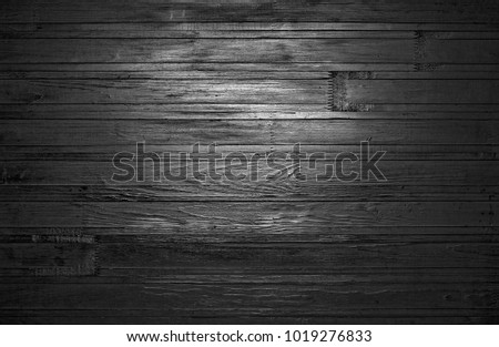 Stock Photo Black wooden background with a bright spot in the center