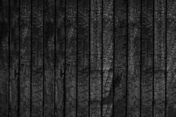 Black wooden board texture, close up. BBQ background. Burnt wooden Board texture. Burned scratched hardwood surface. Smoking wood plank background. Burned wooden grunge texture