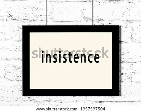 Black wooden frame with inscription insistence hanging on white brick wall  Stock photo ©