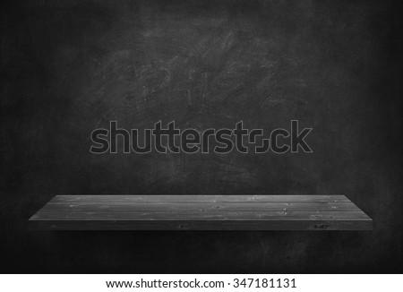 Black wooden plank on dark wall #347181131