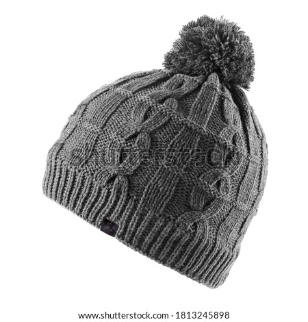 Black Wool Knit Ski Hat with Faux Fur Pompom Isolated on White. Knit Cap Folded Brim. Tuque or Toque Outdoors Headgear. Bobble Hat Topped with Pom Pom or Loose Tassels. Knitted Warm Hat Foto stock ©