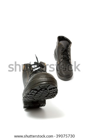 Black working boots run, isolated on white