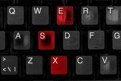 Black worn computer keyboard. The letters