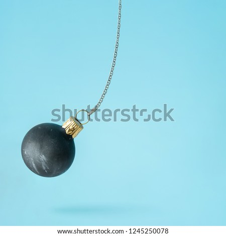 Black wrecking ball Christmas bauble decoration. Minimal New Year concept.