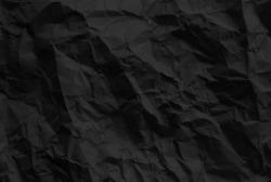 black wrinkled paper texture.