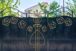 Black wrought iron gates with gold