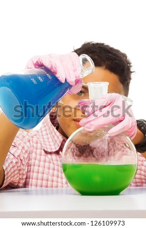 Black 10 years old boy mixing chemicals with two big flasks
