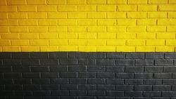 Black yellow brick wall