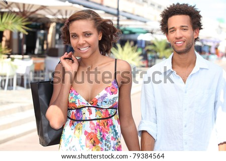 black young couple walking in the street - stock photo
