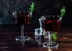 Blackberry Bramble with fresh muddled blackberries, gin, lemon juice, and soda water. Refreshing summer cocktail with ice. low key.