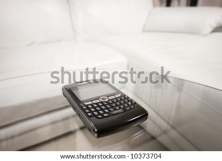 Blackberry on glass table in living room