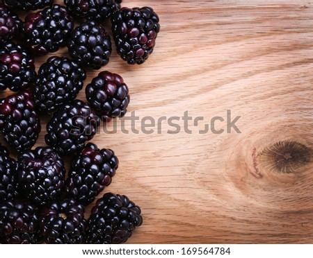 Blackberry on Wooden Background