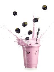 Blackberry smoothie splash with flying fruits