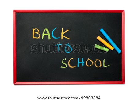 "blackboard and chalks with ""Back to school"""