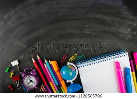 Blackboard and school supplies #1120585706