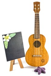 blackboard and vintage ukulele on white