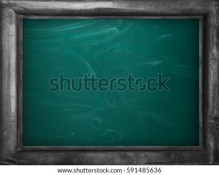 Blackboard / chalkboard texture. Empty blank green chalkboard with chalk traces #591485636