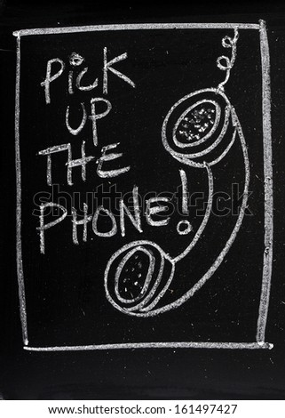 Blackboard concept for fast old fashioned communication avoiding the overuse of email. Pick up the phone written on a blackboard next to a chalk drawing of a telephone handset left dangling