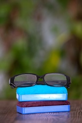 Blackboard eraser and a pair of glasses